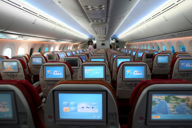 搭飞机座位选在哪里好?退休空姐这么说.(图)