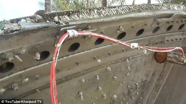 泰国南部沿海发现疑似马航mh370客机碎片(组图)